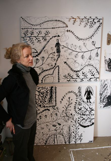 photo of the artist in her studio with monochrome paintings
